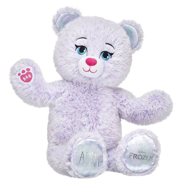 Anna Inspired Bear is back and updated with a new look! This furry friend has soft fur that's a swirly mix of violet and snow white colors. She also has her name on one paw pad and the official Disney Frozen logo on the other. Add Anna's signature dress to your Frozen collection and relive the magic! © Disney
