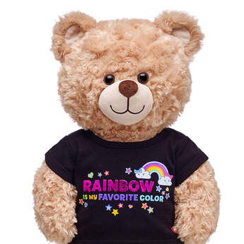 "Your furry friend will be all rainbows and smiles in this cheerful stuffed animal T-shirt! This black tee features an array of hearts, stars and smiley rainbows with a cute ""Rainbow Is My Favorite Color"" graphic on the front. It's the perfect shirt for your furry friend's bright personality!"