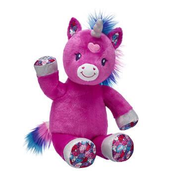 candy hearts unicorn stuffed animal sitting