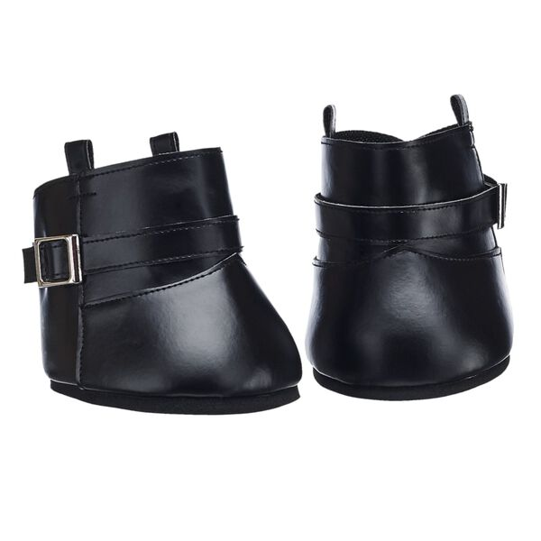 Giddy up! Keep your furry friend looking stylish in a pair of riding boots. These black boots feature a silver buckle.