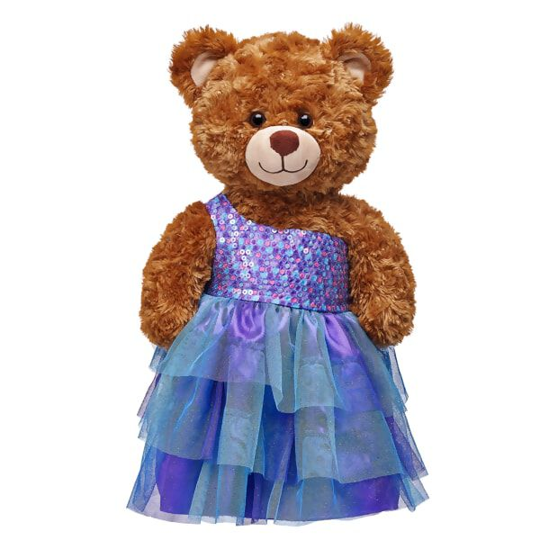 This beautiful One Shoulder Sequin Dress is the perfect way for your furry friend to make a spectacular entrance this spring. This furry friend sized dress has sequin top of varying purple, pink and blue colors. The flowing gown portion is made up of matching layers of blue and purple tulle. This pretty dress is perfect to commemorate any special occasion from prom to galas to weddings.
