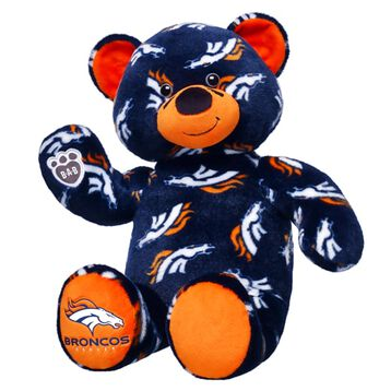 Go Broncos! Cheer on the Broncos with your very own Denver Broncos Bear. This exclusive bear has navy blue fur with Broncos logos all over and Broncos written on its orange paw. Add a Broncos hoodie or fan set to make the perfect gift.Officially Licensed Product of the NFL