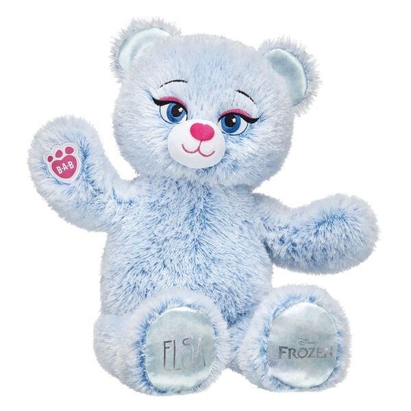 Elsa Inspired Bear is back and updated with a new look! This furry friend has soft fur that's a swirly mix of icy blue and snow white colors. She also has her name on one paw pad and the official Disney Frozen logo on the other. Add Elsa's signature dress to your Disney Frozen collection and relive the magic! © Disney