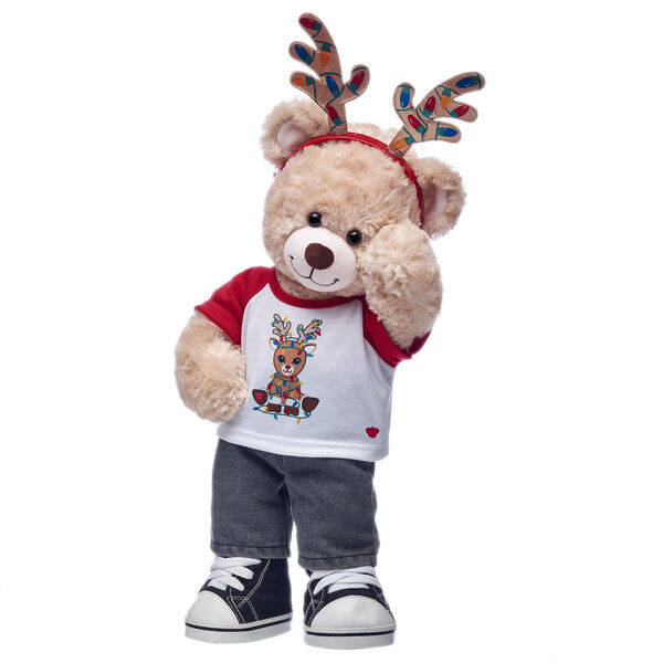 Happy Hugs is making it BEARY and bright this holiday with this festive teddy bear gift set! This adorable plush teddy bear is getting in on the reindeer games with its fun T-shirt and cute antler headband.