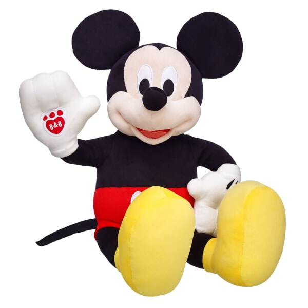 M-I-C-K-E-Y M-O-U-S-E! Cuddle up with Disney's Mickey Mouse, one of the best loved characters throughout the world! The Mickey Mouse furry friend features his famous red shorts, white gloves and yellow shoes. Add his classic tuxedo to complete Mickey's formal look!© Disney