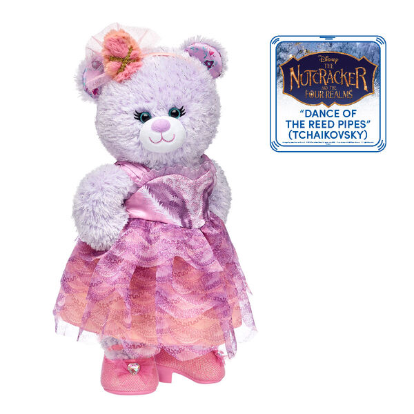 Visions of sugar plums will dance in their heads with this enchanting teddy bear gift set! Little ballerinas and fairies will love twirling with their own Disney Nutcracker Bear and this Sugar Plum Fairy bear costume. The costume includes a pink and purple dress with a matching tulle headband.