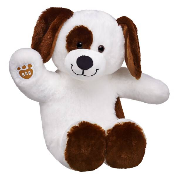 brown and white colored dog stuffed animal sitting and waiving