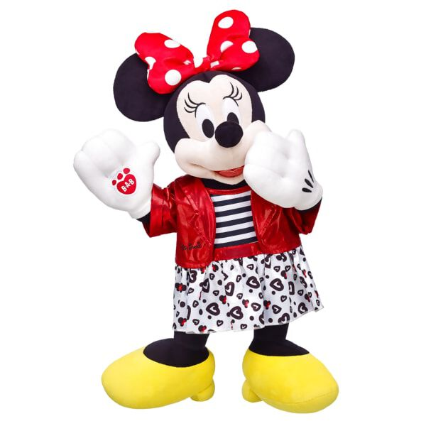 This Disney Minnie Mouse Gift Set contains Disney Minnie Mouse furry friend and Disney Minnie Mouse Red Jacket Outfit. Minnie features her polka dot hair bow, white gloves and yellow shoes. The attached dress features a black and white striped top with red satin trim and heart-pattern skirt.