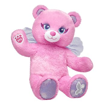 Fairy Bear is an enchanting teddy bear with bright pink plush fur, sparkly paw pads and purple fairy wings. Free shipping on orders over $45.
