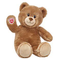 brown teddy bear sitting and waiving