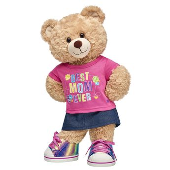 """Mom is BEARY special…so surprise her with a gift set that's as one-of-a-kind as she is! Happy Hugs Teddy comes dressed in a cute outfit and is a perfect way to celeBEARate Mom and all she does. <p>Price includes:</p>  <ul>    <li>Happy Hugs Teddy</li>     <li>Best Mom Ever T-Shirt</li>    <li>Denim Sparkle Skirt</li>    <li>Metallic Low Top Shoes</li> </ul>"""