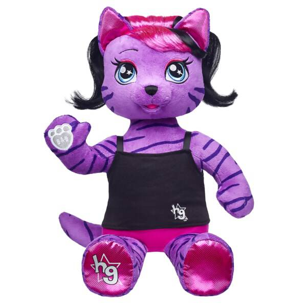 Teegan, the lead singer of the Honey Girls, loves to live big, loud and strong! This purple plush tiger is a fearless leader and a bold writer who believes in the power of being yourself. With soft purple fur with tiger stripes, Teegan also has stylish pink and black hair and shimmery fuchsia paw pads. Add Teegan's signature outfit and accessories to make this artistic plush Tiger the perfect gift. Honey Girls outfits and accessories sold separately.