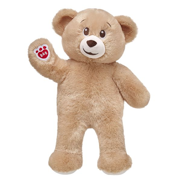 honey colored teddy bear standing