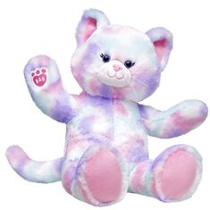 Pounce into a colorful whirl of feline fun with this Pastel Swirls Stuffed Kitty! With fur that's a soft blend of pink, purple and blue colors.