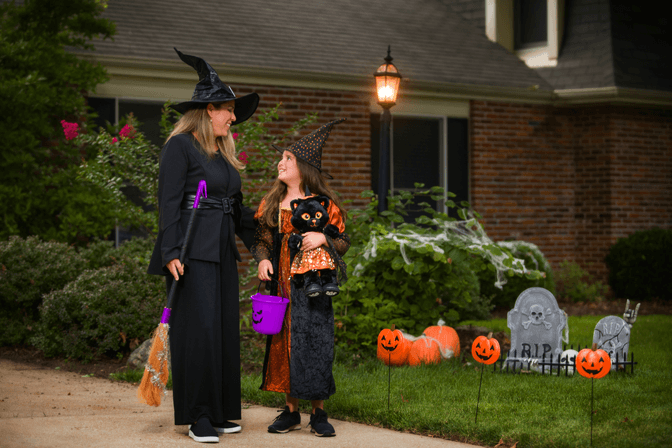 adult and child in witch costumes